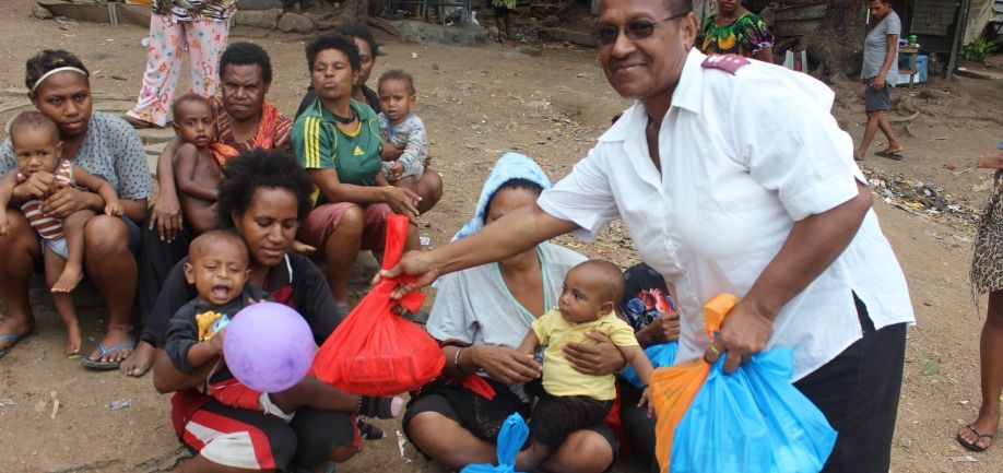 Settlment Ministry Team gives food parcels to mother's with infants at 6mile settlement