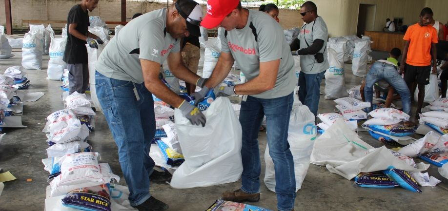 ExxonMobil Managaing Director Andrew Barry with staff assist with packing of the relief supplies